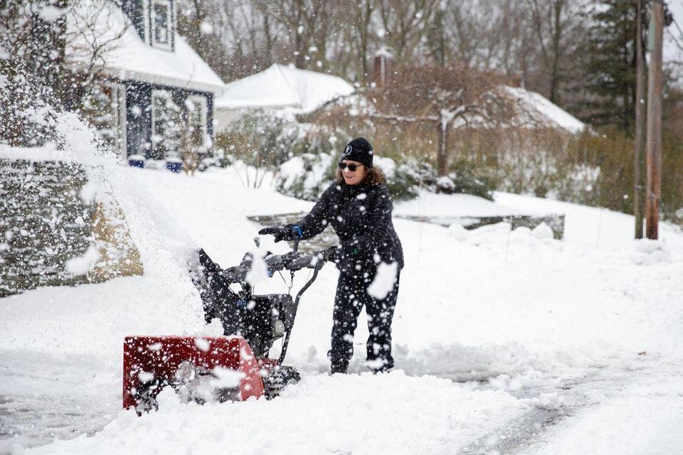 Port Jefferson resident Chris Kelley uses a snow