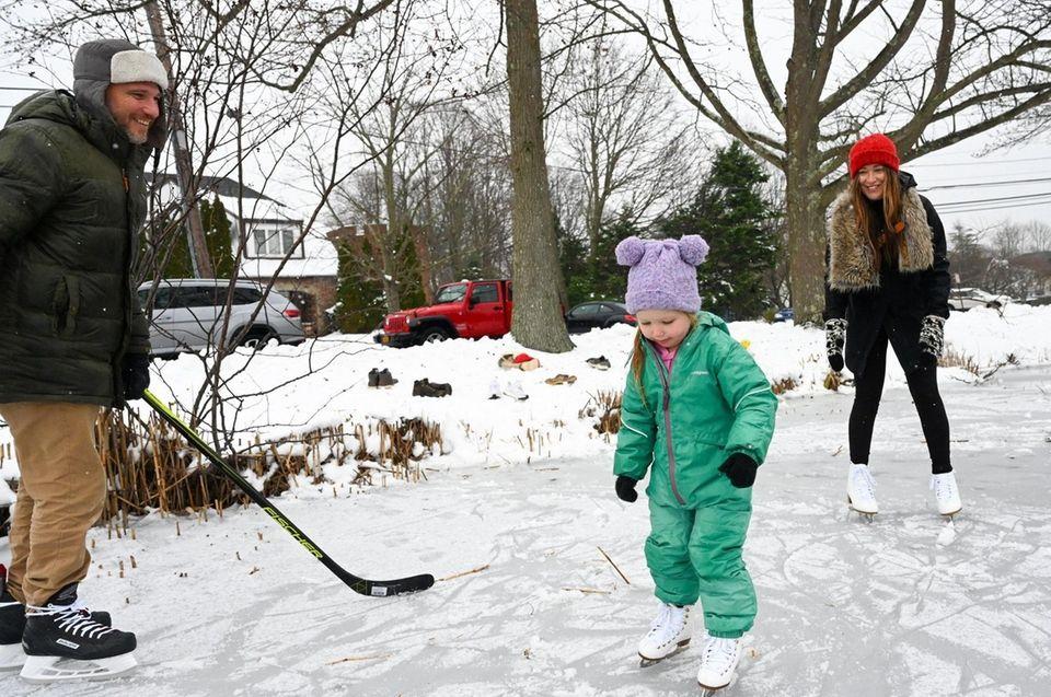 Elodie Meehan, 4, of Brightwaters, skates on ice