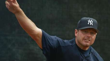 Yankees pitcher Roger Clemens fires a pitch in