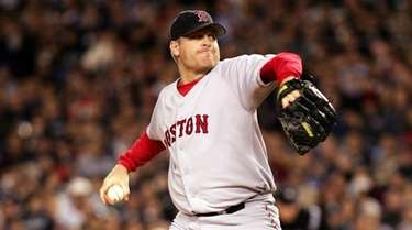 Curt Schilling of the Boston Red Sox throws