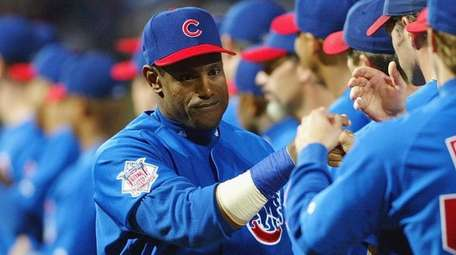 Sammy Sosa of the Chicago Cubs greets teammates