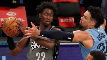 Caris LeVert #22 of the Nets controls the