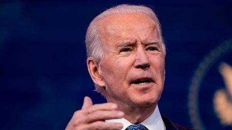 President-elect Joe Biden talks to reporters at The