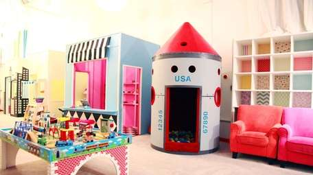 These toys, seats and rocket ship-inspired nook are