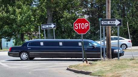 A limousine heading east on Route 48 and