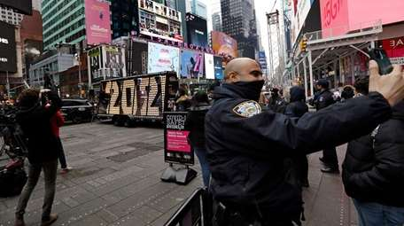 A NYPD officer takes a picture of the