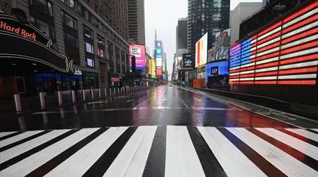 A nearly empty Times Square is seen on