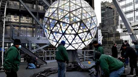 The Times Square crystal ball is illuminated and