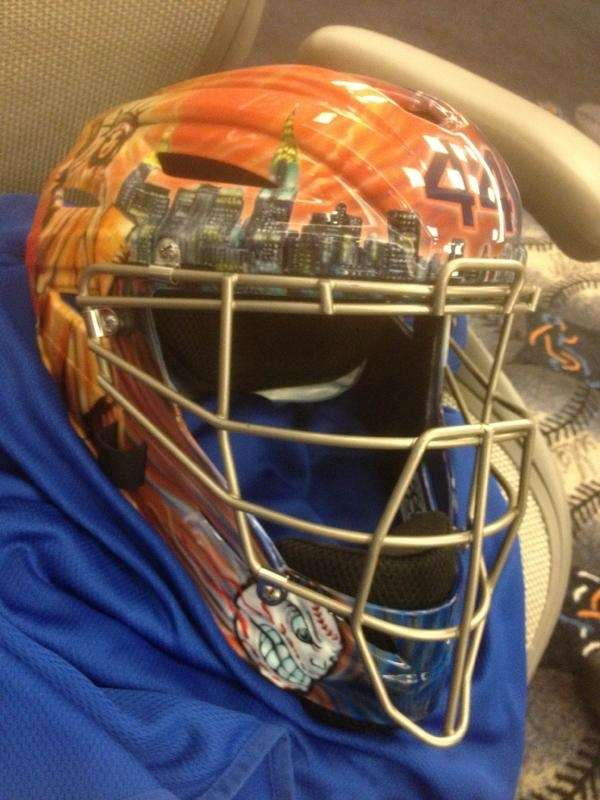 Mets catcher John Buck's customized helmet. (April 4,