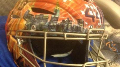 Mets catcher John Buck's customized helmet. (April 4,