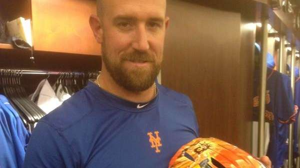 Mets catcher John Buck poses with his customized