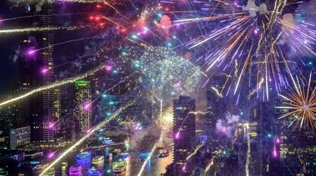 New Year's Eve fireworks erupt over the Chao