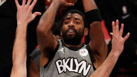 Kyrie Irving of the Nets puts up a