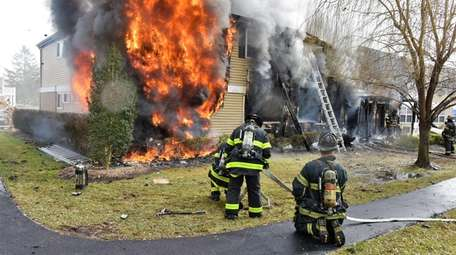 Firefighters at the scene in Ronkonkoma on Friday.