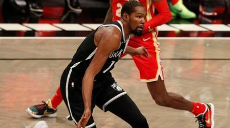 Kevin Durant of the Brooklyn Nets controls the