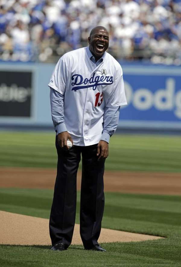 Los Angeles Dodgers owner Magic Johnson laughs as