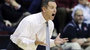 Rutgers head coach Mike Rice reacts to play