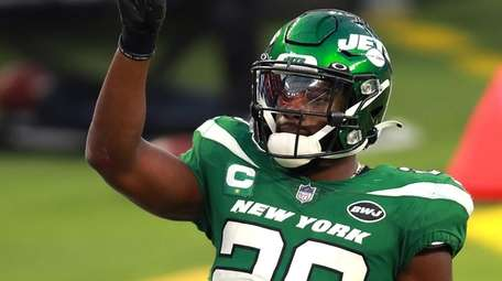 Marcus Maye of the Jets reacts after breaking