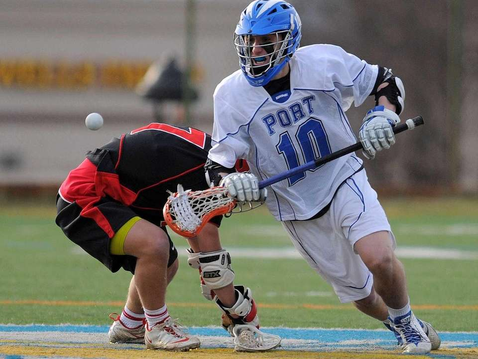 Port Washington's Joey Froccaro, right, goes after a