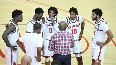 St. John's head coach Mike Anderson talks to