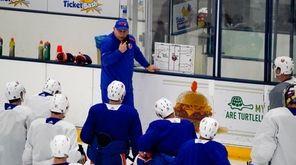 Islanders head coach Barry Trotz speaks to the