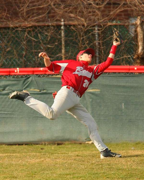 Clarke center fielder John Fogarty makes a running