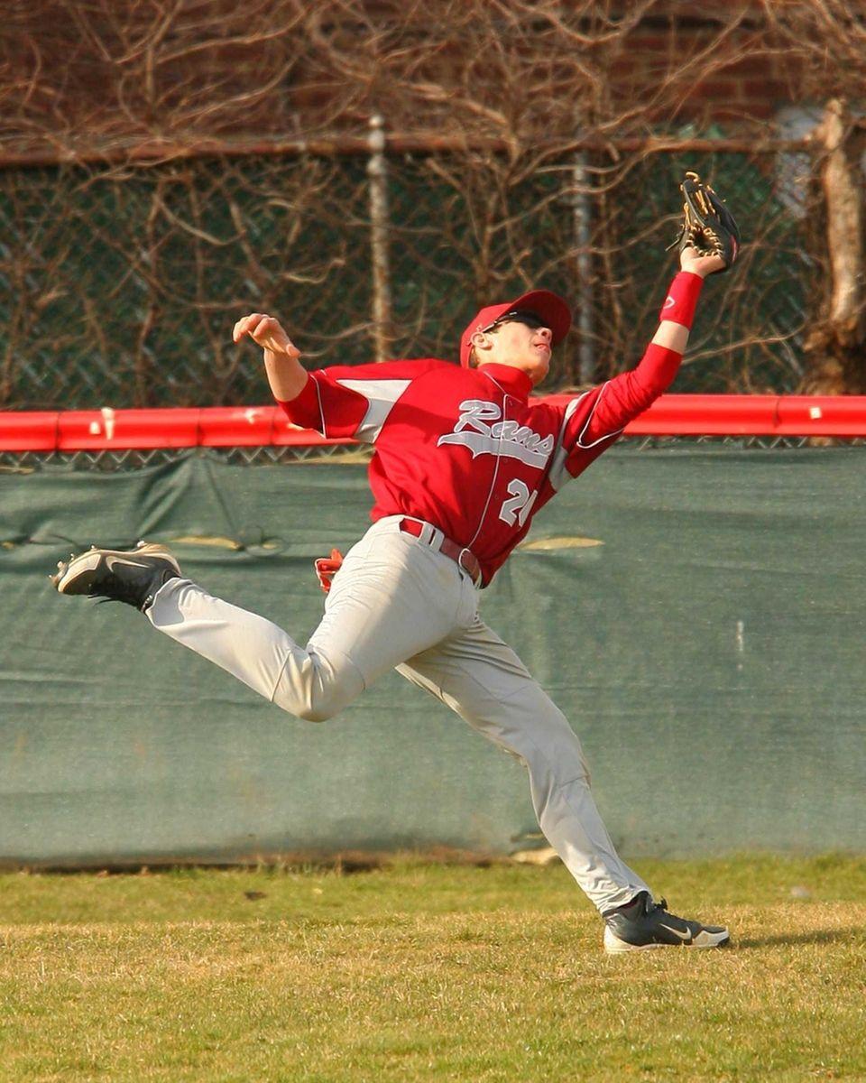 Clarke center fielder John Fogarty makes a running