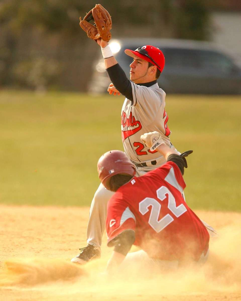 Plainedge's Matt Seelinger steals second base safely as