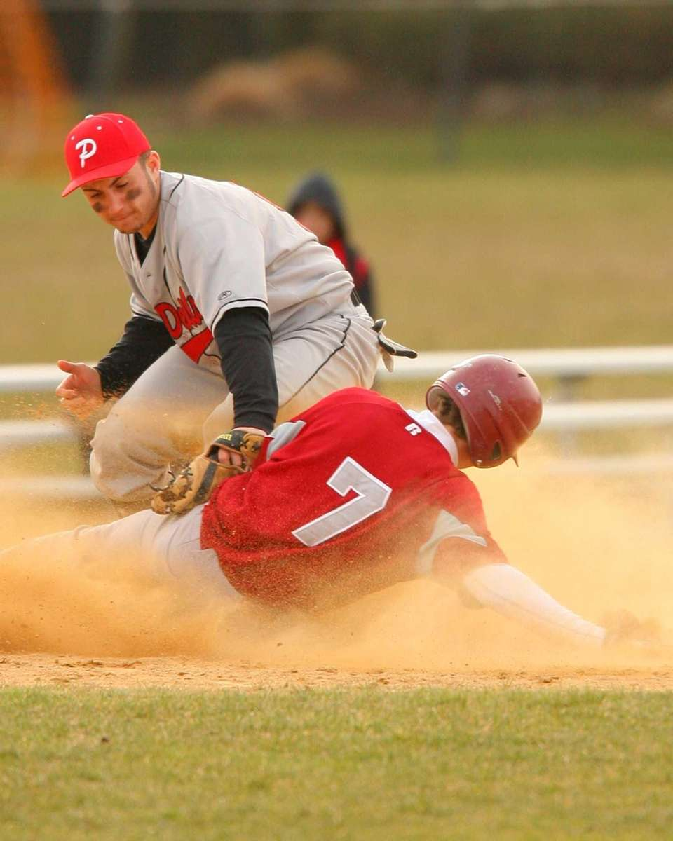 Plainedge's Michael Dotzler puts the tag on Clarke's