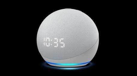 You can use Alexa to set the alarm