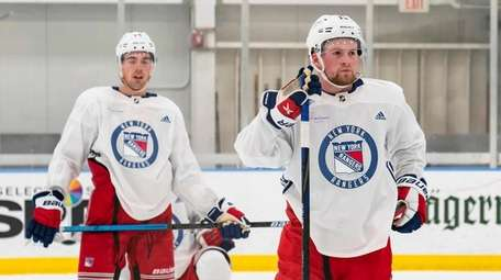 Rangers rookie Alexis Lafreniere, on right, starts the