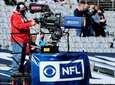 A CBS camera man films the game between