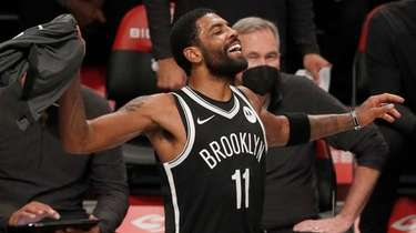 Kyrie Irving of the Brooklyn Nets reacts on