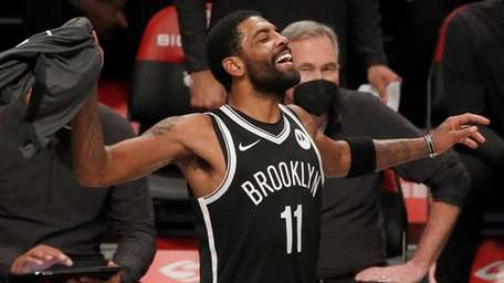 Kyrie Irving of the Nets reacts on the