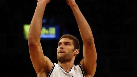 Nets center Brook Lopez lines up a three-pointer