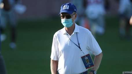 Giants president, CEO and co-owner John Mara watches