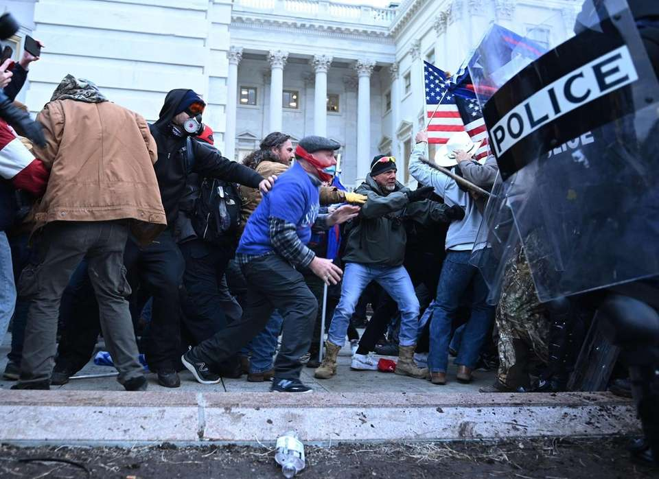 TOPSHOT - Trump supporters clash with police and
