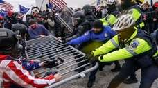 Trump supporters break through a police barrier on