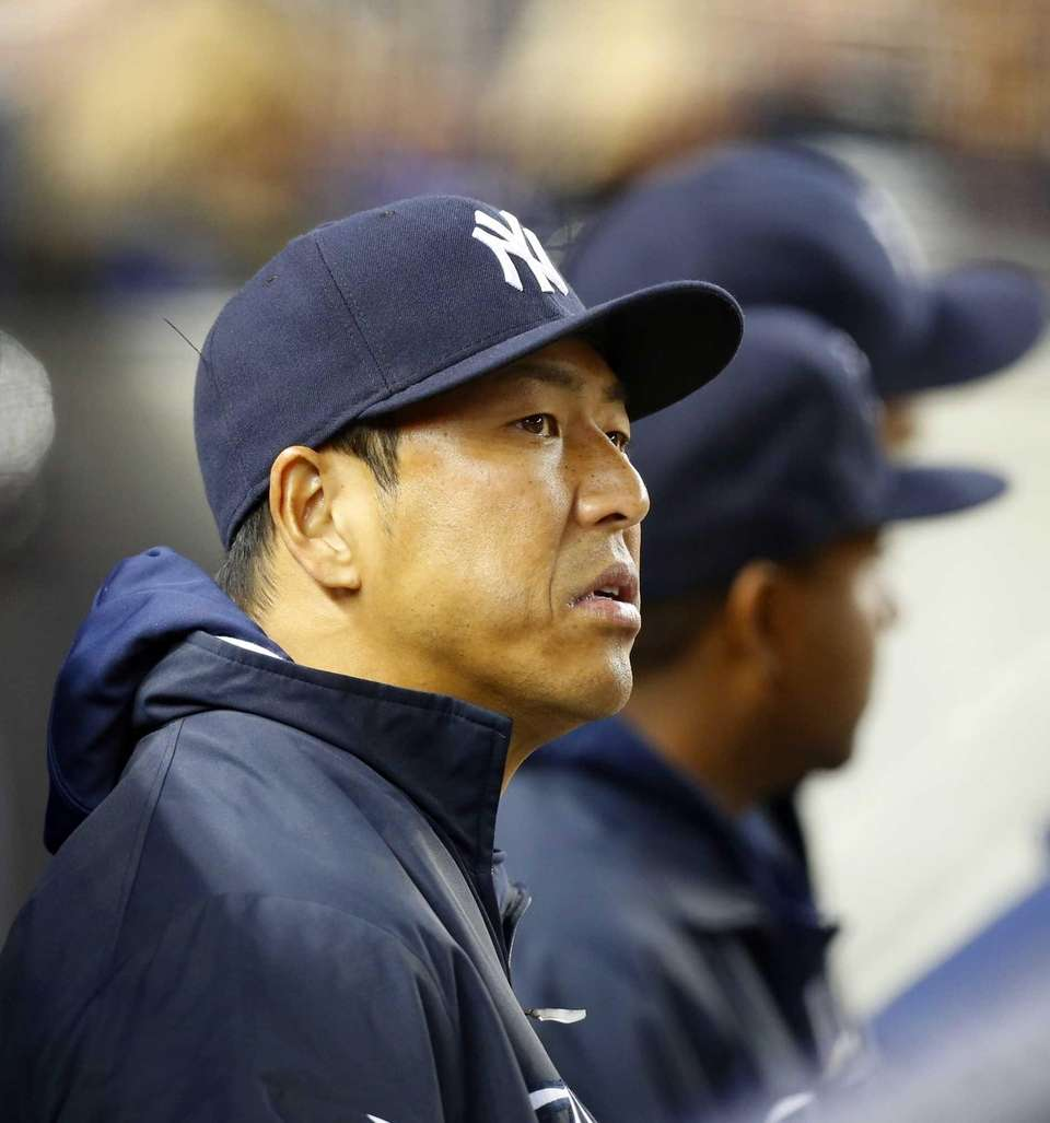 Hiroki Kuroda of the Yankees looks on from