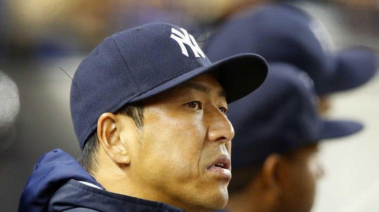 Hiroki Kuroda of the Yankees looks on from