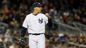 Andy Pettitte of the Yankees reacts after the