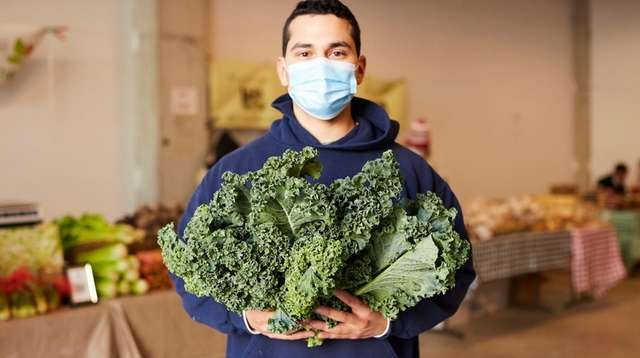 Danny Lopez with curly kale from 4 E