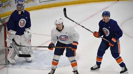 Islanders right wing Oliver Wahlstrom skates in front