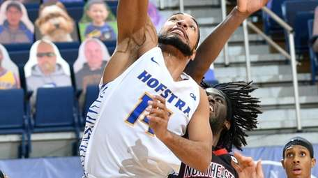 Hofstra's Kevin Schutte finishes off a dunk against