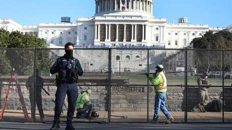 A fence is erected around the U.S. Capitol