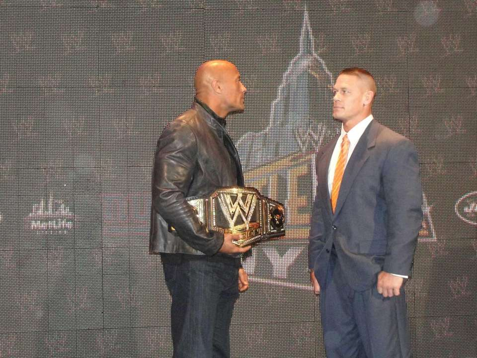 "WWE champion Dwayne ""The Rock"" Johnson, left, and"