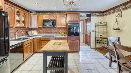 The house has a spacious eat-in kitchen, den