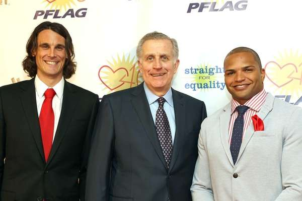 Former NFL Commissioner Paul Tagliabue, center, presented the