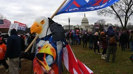 Trump supporters flood the grounds of the Capitol
