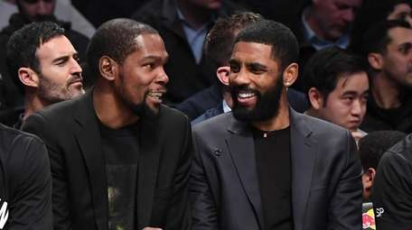 The Nets' Kevin Durant, left, and Kyrie Irving